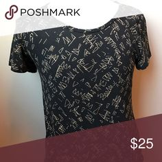 Excellent used condition Lularoe Classic T Medium Worn and washed once per Lularoe recommendations. Black and Tan design. Medium Classic T. Smoke free home. LuLaRoe Tops Tees - Short Sleeve
