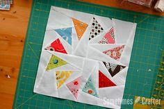 July's block has got to be my favorite – both visually and for how it's pieced. I am far from being an expert at paper piecing, but I've done it a few times and can at least get you started. I we...