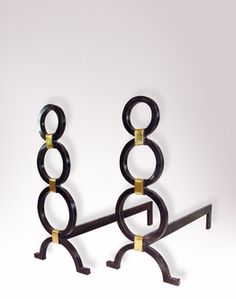 """LA FORGE FRANÇAISE   CHATELET ANDIRONS (blackened /with dutch leaf) 9"""" wide, 18 1/2"""" high"""