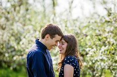 Apple orchard engagement picture by Leah Moss Photography