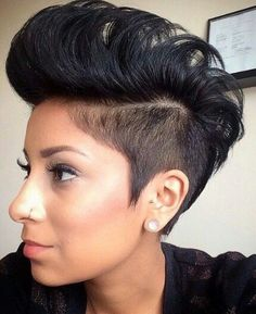"Poofy Mohawk- Although Mohawks have been around for a few years now, stylists are continuing to find ways to modify the look. This cut with a ""poofy"" top is a favorite because it is funky and also feminine too."