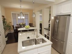 Property Brothers: Two-tier island in kitchen.