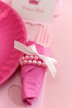 Girls Birthday Party ~ little pearl bracelets serve as napkin rings and as a take home gift for the girls -- @Melissa Bomar - Tea party? For future baby girls birthday