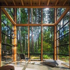 At this rustic retreat near the Puget Sound by Bohlin Cywinski Jackson, exposed wood forms a structural frame that supports a prefabricated aluminum window system—south-facing windows guarantee ample natural light while framing exquisite views of the lush Future House, My House, Architecture Design, Architecture Interiors, Interior And Exterior, Interior Design, Exterior Windows, Design Interiors, Room Interior
