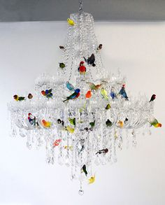 XL Bird Chandelier by Sebastian Errazuriz, a traditional crystal luminaire that is decorated with 50 taxidermied birds. His Chandelier was inspired by a similar lamp that was in the artist's grandm.