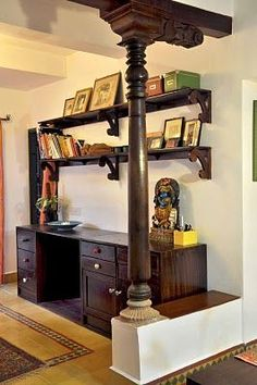 Karthik Vaidhyanathan's new apartment home in Bangalore, India.The workspace cabinets and shelves have been made by Karthik's local carpenter. The knobs on them in various shapes and colours are antiques.