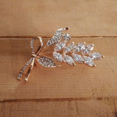 Extremely Beautiful White Stones and American Diamonds Studded Brooch. An absolutely stunning piece to have with highly detailed and precise design.Wear it on your coat, western dress or saree to look beautiful. #modern #newarrivals #brooches #festivefeel