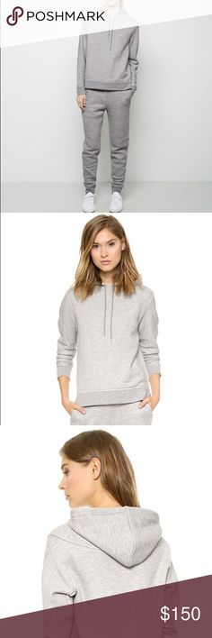 T by Alexander Wang French Terry Tracksuit Elevated, staple sweatshirt in a French terry twill. Hooded with drawstrings, raised side seam detail and straight fit. Elevated, staple sweatpants in a French terry twill. Faux fly detail, slant welt pockets at hips and raised side seam detail. Excellent Condition.                                                                Color: Heather Grey. 80% cotton, 20% polyester; Rib: 64% polyester, 34% cotton, 2% spandex. Model Bust: 31.5 in Height…