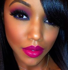 Beautiful smoky eye with pink and yellow accent.