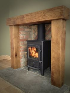 Most current Pics Brick Fireplace surround Suggestions Clearvier pioneer 400 chunky oak surroun reclaimed yorkshire stone hearth herringbone brickwork. Log Burner Living Room, Home Living Room, Living Room Fireplace, Cottage Fireplace, Fireplace Surrounds, Fireplace Design, Fireplace Ideas, Mantel Ideas, Wood Burner Fireplace