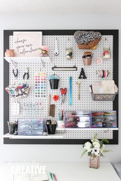 Add beautiful vertical storage to your feminine home office with a DIY pegboard #diyprojectsforhome #homeofficedecor #officedecor #craftroomorganization #craftroom #diyproject #homedecor #officehomedecor #craftroomdecor #officeorganization #bosslady #bossbabe #domesticallycreative