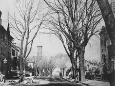 This is an early photo of State St looking up toward the courthouse. On the right is the first Municipal Building and on the left is the Brandegee House before the Crocker House replaced it.