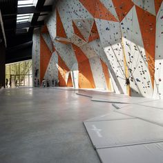 Rock climbing wall at Le Polyedre (rock climbing center in France) by Beal and Blanckaert. Neat!
