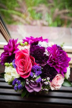 Shades of purple with pops of pink makes for a sweet and fun bridal bouquet. Flowers by Dandie Andie Floral Designs   Photo by LG Weddings See more here: http://www.dandieandiefloraldesigns.com/floral_portfolio/
