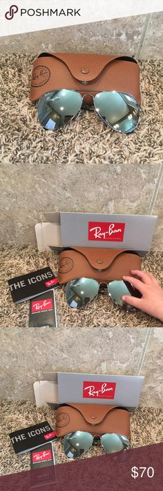 Ray Ban Aviators Silver Mirrored Lenses with silver metal frame, size 58mm. Original, authentic sunglasses that come with, brown leather case, cleaning cloth and box. Ray Ban logo engraved on left top corner of right lens, Ray Ban logo on both nose pads.