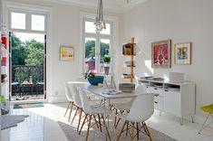 white kitchen, pendant light, balcony and pops of colour
