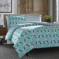 80,Modern and graphic, Brodie takes its design inspiration from brightly colored Moroccan tiles in a classic medallion pattern. Using a cool palette of turquoise and cobalt blue with white, this design manages to be both bold and serene at the same time.