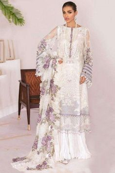 Let the next ethnic occasion see you flaunt a mesmerisingly vibrant avatar wearing this white net sharara suit which makes you effortlessly fashionable. This round neck and full sleeve sharara suit accentuated with thread and sequins work. Accompanied by a matching cotton sharara pants in white color with white net dupatta. Sharara pants are plain. #shararasuits #malaysia #Indianwear #weddingwear #andaazfashion Pakistani Designer Suits, Pakistani Dress Design, Pakistani Suits, Pakistani Fashion Casual, Pakistani Street Style, Pantalon Cigarette, Pakistani Dresses Online, Sharara Suit, Indian Attire