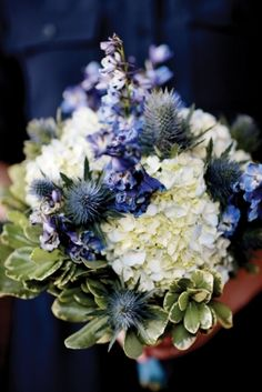 Blue delphinium, blue hydrangea, limonium and thistle flower bouquet.