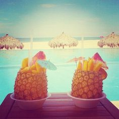 i want to sip alcohlic beverages out of fruit while sitting on the warm sand on a tropical island, tanning my pasty white skin :) haha.