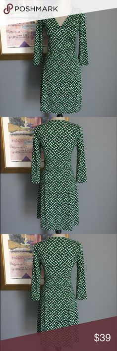 Ann Taylor Loft Faux Wrap Dress Pretty geometric shapes faux wrap dress from Ann Taylor Loft .  Features a hidden side zipper closure .  Made of 100% polyester .  Machine washable .  Lovely for the office or a nice dinner out .  Excellent condition LOFT Dresses Long Sleeve