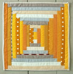 ~ free ~  tutorial:  Courthouse Steps Mini Quilt  at The Purl Bee