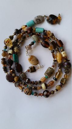 Lux open ended necklace will fascinate! So many different types of beads on this 39 inch open end necklace, from tiger eye chips to turquoise, faceted crystals, glass focal it has it all! Wire Jewelry, Unique Jewelry, Beaded Necklace, Beaded Bracelets, My Etsy Shop, Stones, River, Sculpture, Trending Outfits