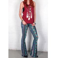 """Boho border print bell bottoms tall girls elephant Not Free People. These are from Gypsan and made in the USA. Elephant border print bell bottoms with an extra wide flare. Stretchy waist for easy, pull-on wear.   Made in USA 95% Rayon, 5% Spandex  Measurements for S:  Waist (all around): 24"""" (unstretched) Rise: 10"""" Inseam: 36""""  Model's Height: 5'11"""" Wearing Size S  Size Free People Pants Boot Cut & Flare"""