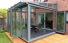 Grey Aluminium Glass Extension Built by Hazlemere Brick Extension, House Extension Plans, Glass Extension, Extension Ideas, Grey Window Frames, Grey Windows, Garden Room Extensions, House Extensions, Modern Conservatory