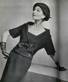 1957 Simone is wearing a blue Shetland wool two-piece dress by Christian Dior, L'Officiel