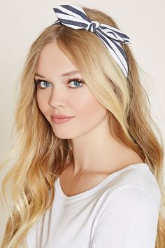 A striped woven headwrap with an elasticized back and a top bow accent.