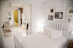 all in white studio apartment with some interesting details