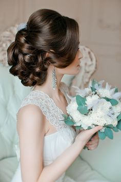 Beautiful softly curled upswept hairstyle