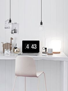 When it comes to Scandinavian-style work spaces, keep things as pared back as possible and display mostly utilitarian objects, like pen holders, pendant lights, and a few tech accessories. Choose work-surface accessories with simple shapes so as not to disrupt the sight line of the room./