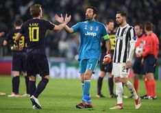 Harry Kane of Tottenham Hotspur and Gianluigi Buffon of Juventus shake hands after the UEFA Champions League Round of 16 First Leg match between Juventus and Tottenham Hotspur at Allianz Stadium on February 13, 2018 in Turin, Italy.
