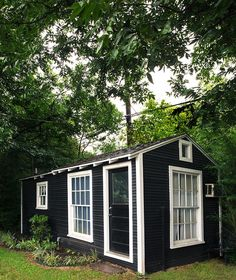 Tutned inyo a mini-house♡The shed's dark exterior juxtaposes its light and airy interiors. Source: Cody Ulrich via Homepolish oasis ideas she sheds Backyard Sheds, Outdoor Sheds, Tiny Backyard House, Backyard Cottage, Converted Shed, Shed Office, Shed To Tiny House, Shed Into House, Tiny Guest House