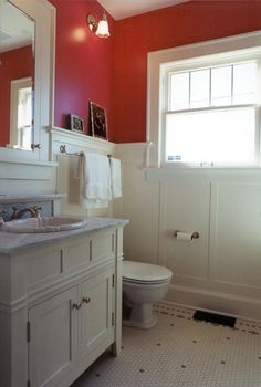 Love, the red, but I have had a bad experience with painting a bathroom Red.  The White paneling should help.