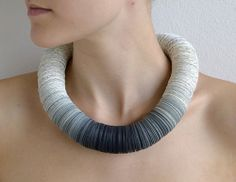 Jewelry made from book pages by etsy seller Dorisse, Based in Munich, Germany.
