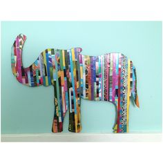 Elephant Magazine Art! Just draw out a silhouette of a animal, then cut and glue strips of a old magazine on it.