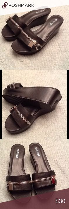 Black Wedge Sandal Brand new without the original box. Made by Nine West with the style name of Coconutty. Black leather with a silver zipper. Wedge is 2.5 inches Nine West Shoes Wedges