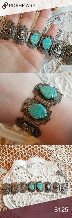 Wonderful Vtg Egyptian Souvenir bracelet scarab This awesome vintage Egyptian Souvenir bracelet has 3D pharoahs, elephants, crescent moon, and turquoise glass Scarab beetles on filigree panels. A Hamsa hand charm hangs on the end. It is made of silver tone metal. Adjustable length with hook and chain clasp. Exact age is unknown, 1960s or earlier for sure, maybe 1920s. In great shape with no major flaws. Offers welcome:)  8988egypt7d6e Vintage Jewelry Bracelets