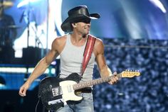 Someone has been hitting the gym. GRAMMY winner Tim McGraw bares his muscles during a performance on May 8 in Fresno, Calif.