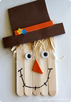 Popsicle stick scarecrow craft.