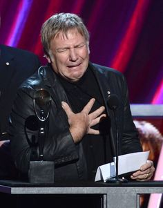 Inductee Alex Lifeson of Rush speaks on stage at the 28th Annual Rock and Roll…