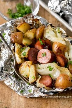 Cabbage, sausage, potatoes, onion seasoned with garlic butter served in a foil packet.