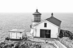Historical Light Fine Art Photography Prints For Sale By Priya Ghose - The Point Reyes Lighthouse, or Point Reyes Light Station is located in Point Reyes, California, and operated from 1870 through 1975. This historic landmark is now preserved as a visitor center, and many visitors brave the extremely high winds and frequent fog to learn more about this part of California history. #BlackAndWhite #Photography #Lighthouses