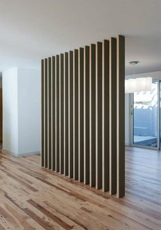 love this room divider in a home done by Austin architects Webber Studio