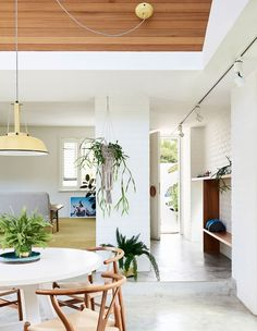 Earthy modern dining room with mid century modern furniture - love the bright walls and warm wood accents // A Photographer + Stylist's Vibrant Family Home