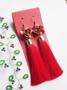 Long red tassel earrings decorated with polymer clay flower | Etsy Rainbow Palette, Polymer Clay Flowers, Real Flowers, Flower Photos, Tassel Earrings, Hippie Boho, The Help, Tassels, Gifts For Her