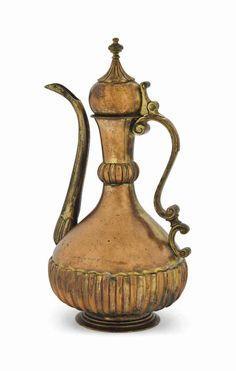 A GILT-COPPER (TOMBAK) EWER